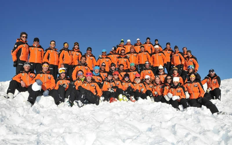 Ski school instructors team photo